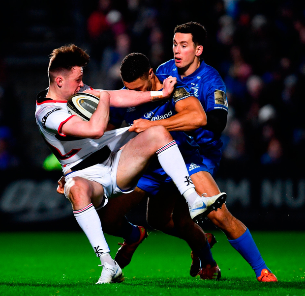 Bruce Houston of Ulster is tackled by Adam Byrne of Leinster. Photo: Ramsey Cardy/Sportsfile