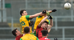 6 January 2019; Martin McElhinney and Hugh McFadden of Donegal in action against Aaron McClements and Daniel McCarthy of Down during the Bank of Ireland Dr McKenna Cup Round 2 match between Down and Donegal at Pairc Esler, Newry, Co. Down. Photo by Oliver McVeigh/Sportsfile