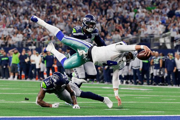 Flying Cowboy: Dallas Cowboys quarterback Dak Prescott (4) is tackled at the one-yard line by Tedric Thompson of the Seattle Seahawks last weekend. Photo: Tim Heitman-USA TODAY Sports