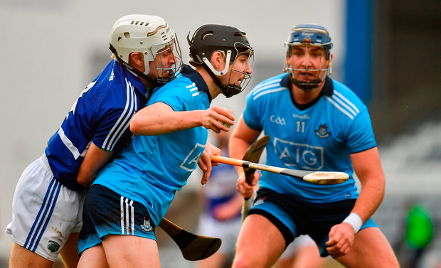 Donal Burke of Dublin in action against Joe Phelan of Laois. Photo by Brendan Moran/Sportsfile
