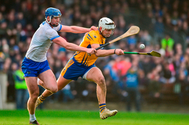 Clare and present danger: Aron Shanagher tries to get away from Waterford's Conor Prunty at Fraher Field. Photo by Matt Browne/Sportsfile