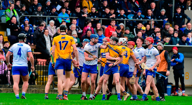 Waterford and Clare players tussel. Photo by Matt Browne/Sportsfile