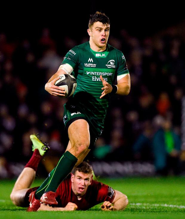 Connacht centre Tom Farrell escapes the clutches of Munster counterpart Chris Farrell. Photo: Diarmuid Greene/Sportsfile