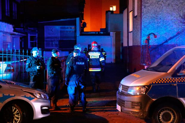 Emergency: Police and firefighters at the scene of the fire in an escape room in Koszalin, Poland, on Friday night. Photo: Reuters