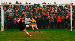 Spot-on: Leitrim goalkeeper Diarmuid McKiernan watches on as Mayo's Jason Doherty scores the opening penalty in the shoot-out at Páirc Seán Mac Diarmada. Photo by Stephen McCarthy/Sportsfile