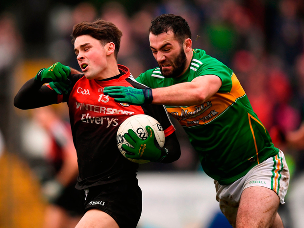 Colm Moran of Mayo in action against Fergal McTague of Leitrim. Photo by Stephen McCarthy/Sportsfile