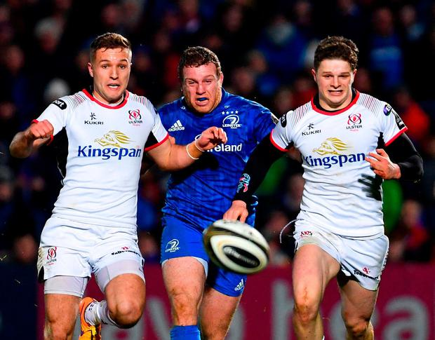 Seán Cronin races against Ulster duo Johnny McPhillips (left) and Angus Kernohan. Photo: Ramsey Cardy/Sportsfile