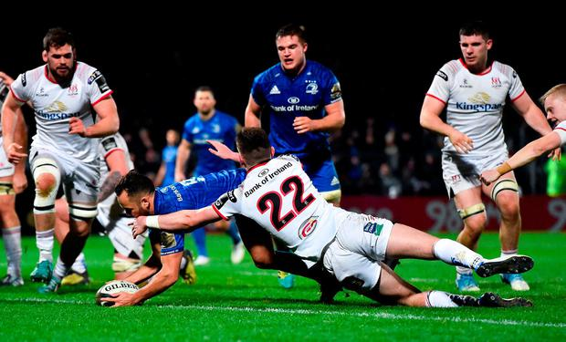 Jamison Gibson-Park evades the tackle of Bruce Houston to score a try for Leinster. Photo: Seb Daly/Sportsfile
