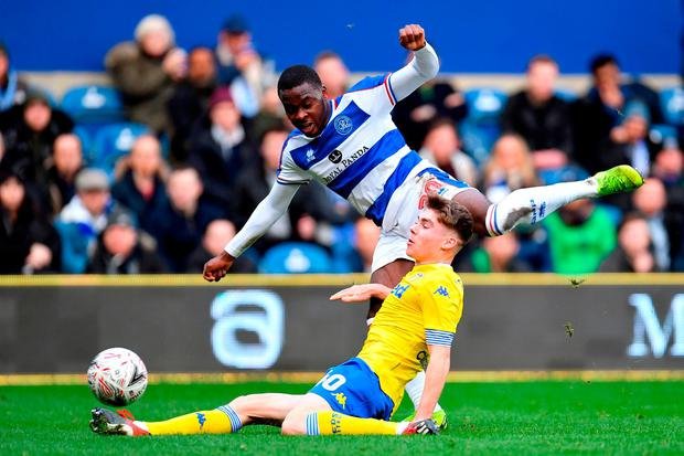Queens Park Rangers' Bright Osayi-Samuel and Leeds United's Leif Davis challenge for the ball. Photo: Justin Setterfield/Getty Images