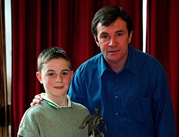Padraig receiving an U-11 Player of the Tournament award from Ray Houghton