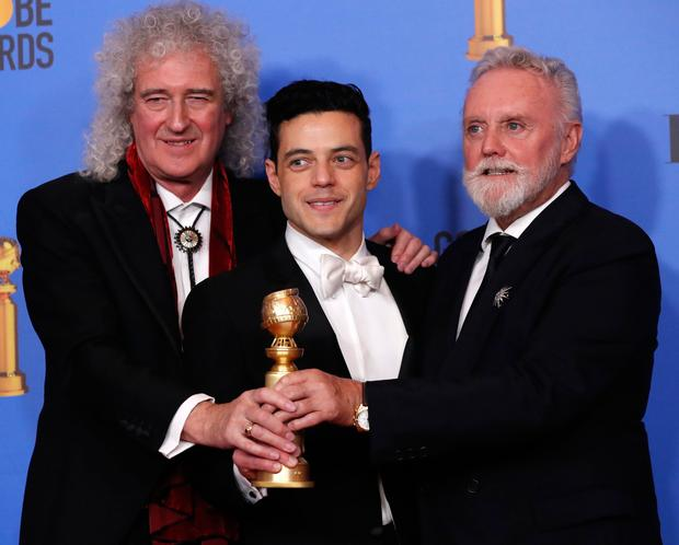 Rami Malek (C) poses backstage with his award for Best Performance by an Actor in a Motion Picture Drama for