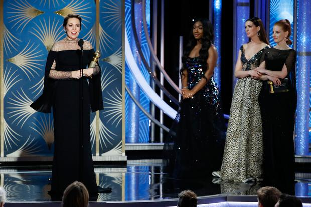 This image released by NBC shows Olivia Colman accepting the award for best actress in a comedy film for her role in