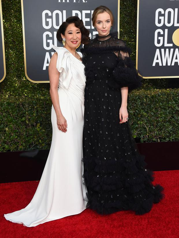 Sandra Oh, left, and Jodie Comer arrive at the 76th annual Golden Globe Awards at the Beverly Hilton Hotel on Sunday, Jan. 6, 2019, in Beverly Hills, Calif. (Photo by Jordan Strauss/Invision/AP)
