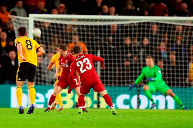 Ruben Neves (left) fires the winner for Wolves during their victory over Liverpool. Photo: Catherine Ivill/Getty Images