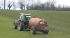 Farmer spreading slurry in a field