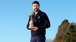 Padraig Harrington poses with the Ryder Cup. Photo: Action Images via Reuters