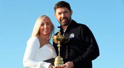 Pádraig with the Ryder Cup and his wife Caroline. Photo: Action Images via Reuters/Peter Cziborra