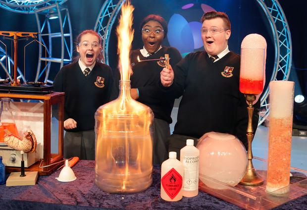 Ready for action: Sophie Kelly (16), Rachelle Biayi (16) and Karl Fitzpatrick (15), pupils from Pobalscoil Neasáin, Baldoyle in Dublin, at the launch of the BT Young Scientist and Technology exhibition 2019, which runs at the RDS from today until Saturday. Photo: Damien Eagers