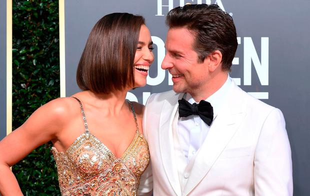 Bradley Cooper (R) and his partner Russian model Irina Shayk arrive for the 76th annual Golden Globe Awards on January 6, 2019, at the Beverly Hilton hotel in Beverly Hills, California. (Photo by VALERIE MACON / AFP)