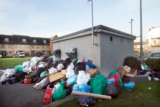 Piles of uncollected refuse at the Applewood Estate in Swords, Co. Dublin Photo: Tony Gavin