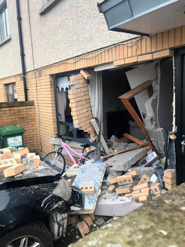 Picture shows how car crashed into front of house