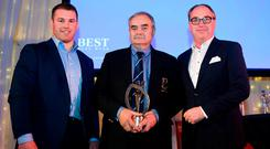 Hall of Fame award winner Roger Anderson of Athy RFC with Sean O'Brien and John Smith of Best Menswear. Photo: Sportsfile