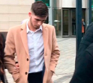 Irish League footballer Jay Donnelly (23) leaves Belfast Magistrates' Court where he was handed a four-month prison sentence for distributing an indecent image of a child. PA Wire