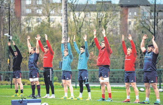 Ciaran Parker going through his streches (far right) with teammates Sam Arnold, Arno Botha, Chris Farrell, Rory Scannell, Conor Murray, Darren O'Shea and Andrew Conway. Photo: Diarmuid Greene/Sportsfile