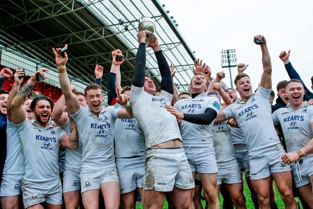 Cork Con captain Niall Kenneally lifts the Munster Senior Challenge Cup