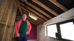 Burned: David O'Hanlon in his damaged home after being left more than €18,000 out of pocket. Photo: Colin O'Riordan