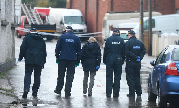 Clues: Gardaí search the scene of the shooting in St Laurence Terrace in Bray, Co Wicklow. Photo: Justin Farrelly