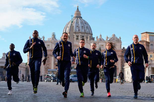 In the running: The Athletic Vatican sports team run for the media in front of St Peter's basilica, at the Vatican. AP Photo/Andrew Medichini