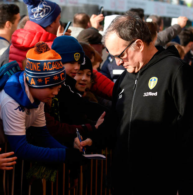 Leeds by example: Leeds United Marcelo Bielsa signs autographs for fans at Elland Road where he has become a hugely popular figure. Photo: George Wood/Getty Images