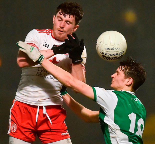 Tyrone's Rory Brennan battles for possession with Conor McHugh of Fermanagh on Wednesday night when defensive play dominated the action, which some believe is down to the limit placed on the handpass in the experimental rules. Photo: Oliver McVeigh/Sportsfile