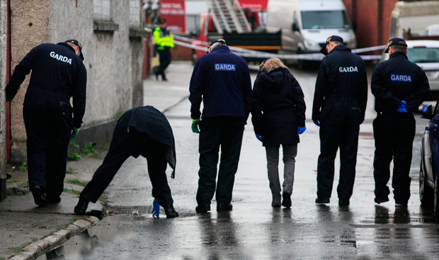 Gardai examine the scene where Stephen Somers was shot at least twice by an unknown assailant