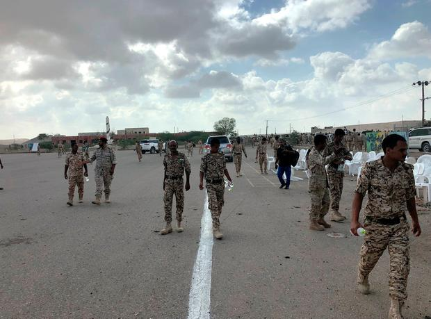 Soldiers inspect the scene of a Houthi drone attack at a Yemeni government military parade. Photo: REUTERS/Stringer