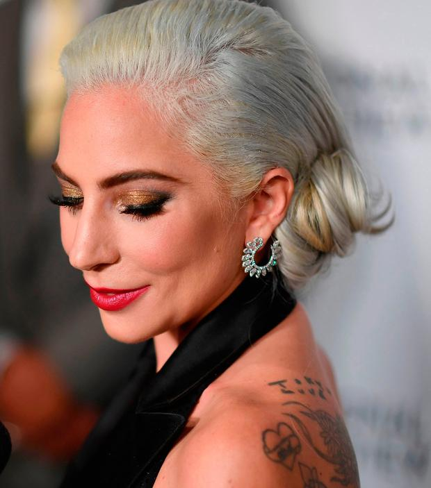 Apology: Lady Gaga said she is sorry for her 'poor judgment' when she was young and for not speaking out sooner. Photo: WEISS/AFP/Getty Images