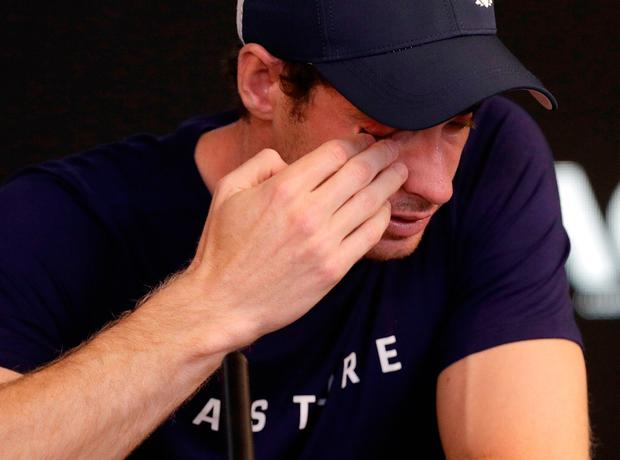 Andy Murray wipes tears from his face during a press conference at the Australian Open