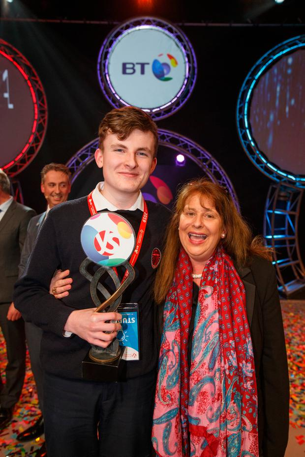 Adam Kelly from Skerries Community College, Co Dublin winner of the BT Young Scientist & Technologist Award 2019 celebrates with his mother Carol Moroney Pic:Mark Condren