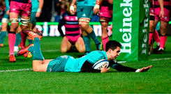 11 January 2019; Joey Carbery of Munster dives over to score his side's first try during the Heineken Champions Cup Pool 2 Round 5 match between Gloucester and Munster at Kingsholm Stadium in Gloucester, England. Photo by Seb Daly/Sportsfile