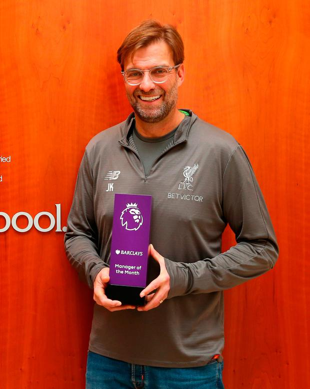 Jurgen Klopp shows off his manager of the month award for December. Photo: Getty
