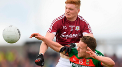 Galway's Sean Andy Ó'Ceallaigh battles for the ball with Mayo's Andy Moran during last year's Connacht SFC clash between the two countieshigher. Photo: Eóin Noonan/Sportsfile