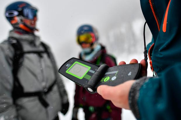 Backcountry skiers check their avalanche beacons at a ski resort on January 10, 2019 in Lermoos, Austria. (Photo by Philipp Guelland/Getty Images)