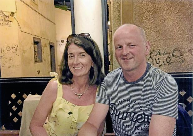 Match: Liverpool fan Seán Cox pictured with his wife Martina before he was attacked