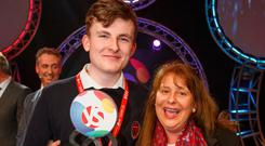 Adam Kelly, from Skerries Community College, Co Dublin, celebrates with his mother Carol Moroney after winning the BT Young Scientist & Technologist Award 2019. Picture: Mark Condren