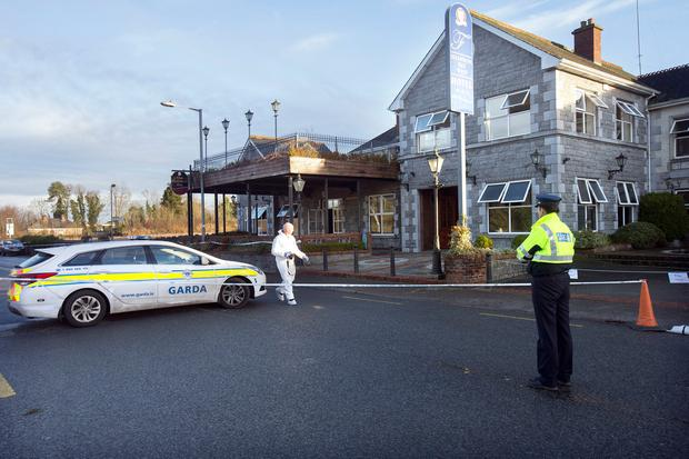 Probe: Garda forensic officers outside the Shannon Key West Hotel in Rooskey after the fire in January. Photo: Tony Gavin