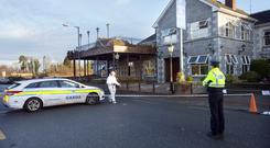 Probe: Garda forensic officers outside the Shannon Key West Hotel in Rooskey after the fire. Photo: Tony Gavin