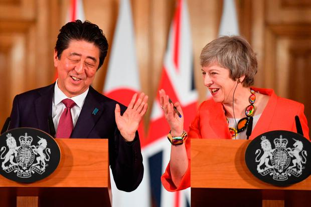 Double act: Japanese Prime Minister Shinzo Abe met British Prime Minister Theresa May at 10 Downing Street yesterday. Picture: Getty