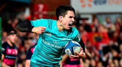 Joey Carbery of Munster celebrates after scoring his side's first try during the Heineken Champions Cup Pool 2 Round 5 match between Gloucester and Munster at Kingsholm Stadium in Gloucester, England. Photo by Seb Daly/Sportsfile