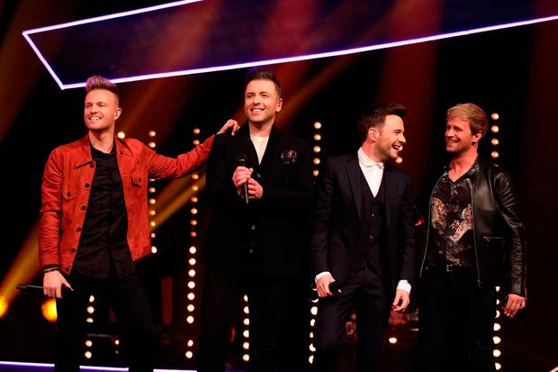 Westlife, (left to right) Nicky Byrne, Markus Feehily, Shane Filan and Kian Egan) during the filming for the Graham Norton Show